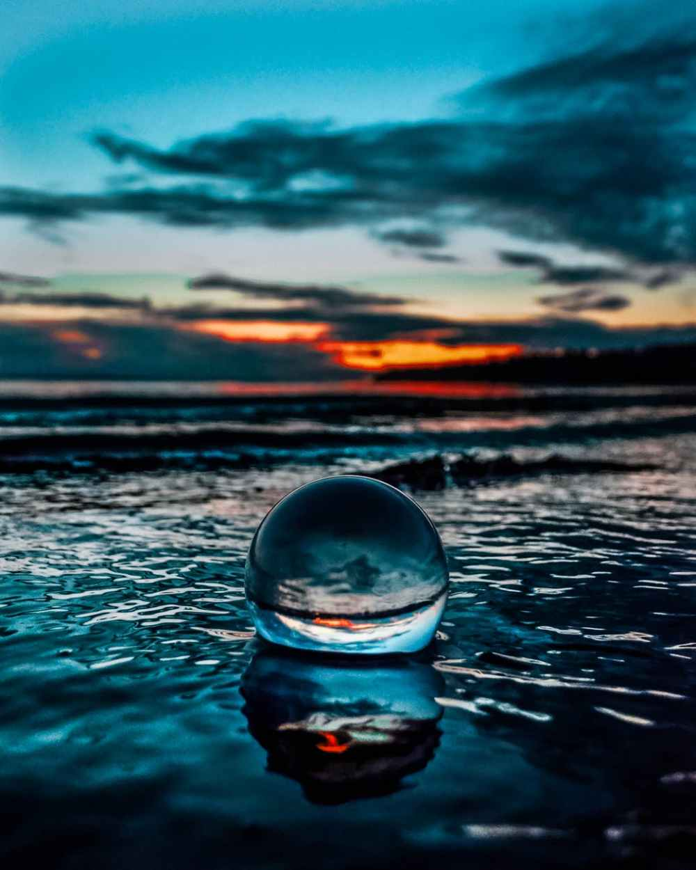 crystal ball on body of water